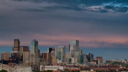 denver skyline at sunrise: A view of Denver, Colorado downtown right before sunset Editorial