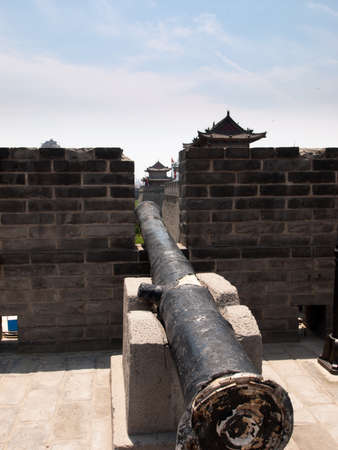 brich: Old artillery on display in Xians city wall, Xian China.