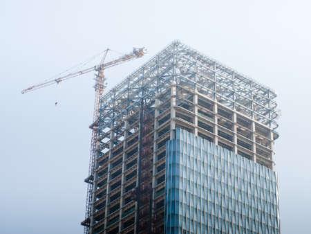 De bouw van de hoogbouw in Shanghai, China.