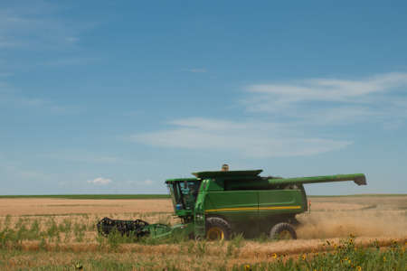 farm equipment: Farm equipment on the field at the harvest time.
