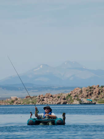 Fly fishing from the float tube at Eleven Mile Reservoir, Colorado.