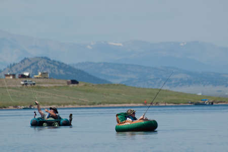 Father and son fly fishing from the float tubes at Eleven Mile Reservoir, Colorado.