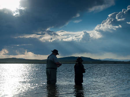 Father and son fishing at Eleven Mile Reservoir, Colorado. photo
