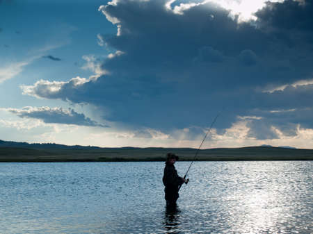 Boy fishing at Eleven Mile Reservoir, Colorado.