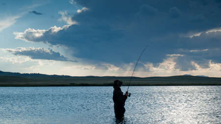 mile: Boy fishing at Eleven Mile Reservoir, Colorado.
