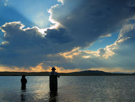 Father and son fishing at Eleven Mile Reservoir, Colorado. Stock Photo - 10319003
