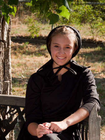 Amish girl on the bench.