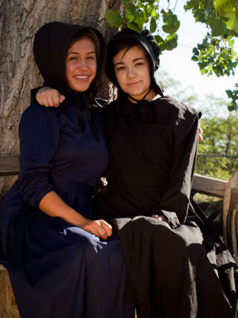 amish: Two amish girls on the bench. Editorial