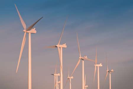 Wind turbines over a beautiful sunflowers field in Limon, Colorado. Stock Photo - 10366190