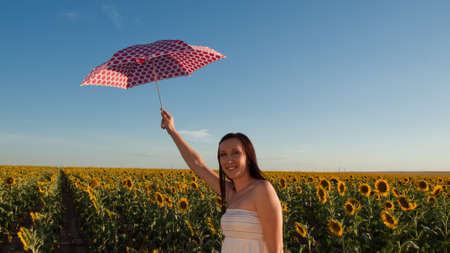 Young woman in sunflower field. Stock Photo - 10377959