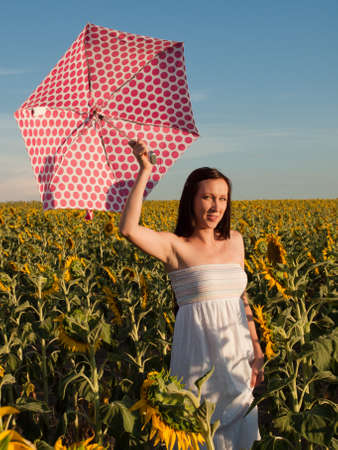 Young woman in sunflower field. photo