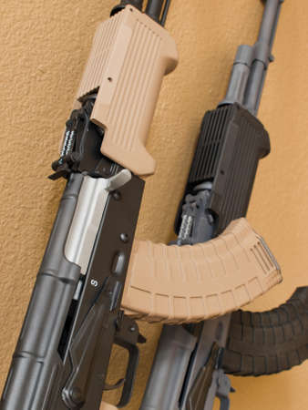 Custom painted AK-47 with a 30 round magazine and a folding stock.