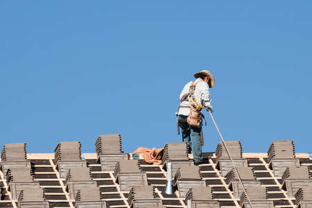 residential construction: Roof repairs of an apartment building in Colorado. Editorial