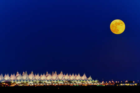 denver at sunrise: Full moon over the Denver International Airport in Colorado.