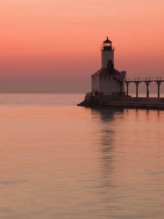 stock agency: Sunset at Michigan City Lighthouse, Michigan City Indiana.