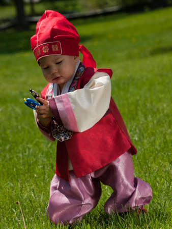 Asian baby, one year old child wearing the traditional Korean cultural ethnic attire, called han-bok. photo