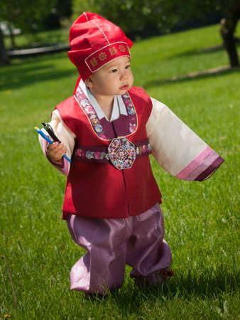 ethnic attire: Asian baby, one year old child wearing the traditional Korean cultural ethnic attire, called han-bok.