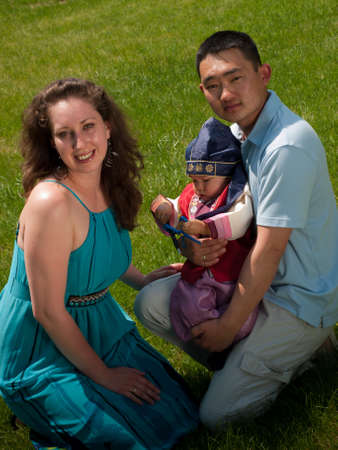 ethnic attire: Family celebrating first birthday of their son. Asian baby, one year old child wearing the traditional Korean cultural ethnic attire, called han-bok.