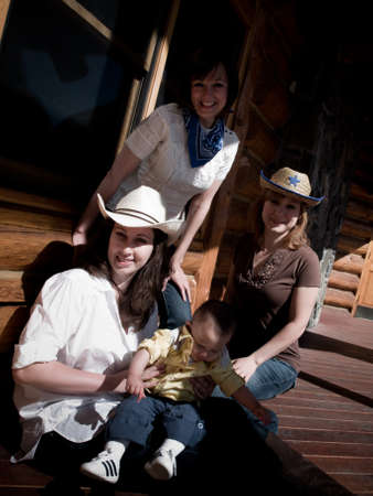 Family with toddler dressed up in cowboy clothes. photo