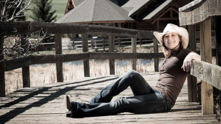 Women with cowboyhat and a smile. photo