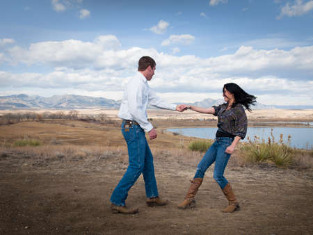 cowgirl boots: Country swing dancing at the foothill of mountains.