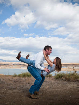 Country swing dancing at the foothill of mountains. photo