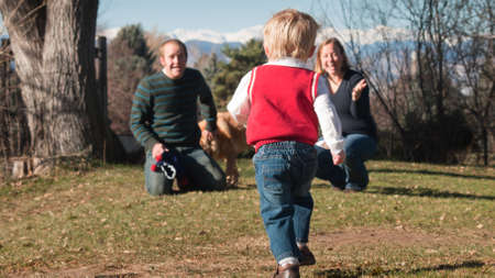 Young family having a great day in the park. photo