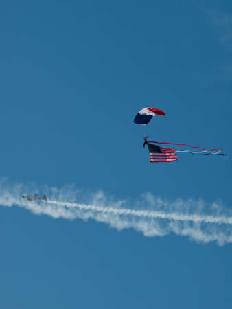 broomfield: Walter Green flying the American flag at the Rocky Mountain Airshow in Broomfield, Colorado. Editorial
