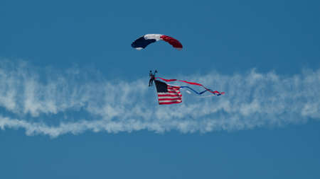 Walter Green flying the American flag at the Rocky Mountain Airshow in Broomfield, Colorado.