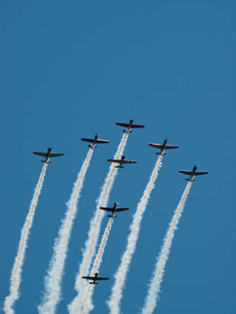 Vintage airplane flying in formation at the Rocky Mountain Airshow in Broomfield, Colorado. photo