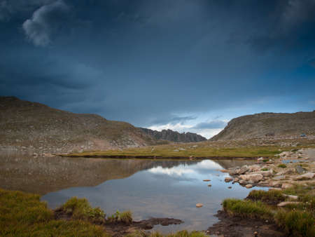 summit lake: Beautiful Summit Lake reflects towering Mt. Evans and is surrounded by lush vegetation. Colorado.