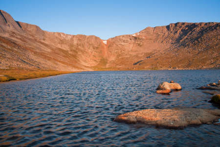 treeline: Beautiful Summit Lake reflects towering Mt. Evans and is surrounded by lush vegetation. Colorado.