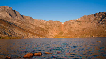 Beautiful Summit Lake reflects towering Mt. Evans and is surrounded by lush vegetation. Colorado. Stock Photo - 10657185