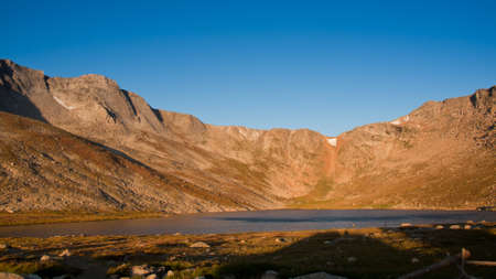 Beautiful Summit Lake reflects towering Mt. Evans and is surrounded by lush vegetation. Colorado. photo