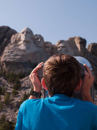 mt rushmore: Boy looking at the Mt. Rushmore National Monument, South Dakota. Editorial