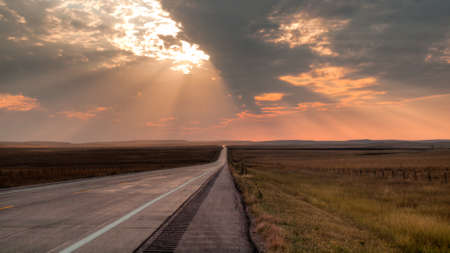 Long road at the sunset in South Dakota. photo