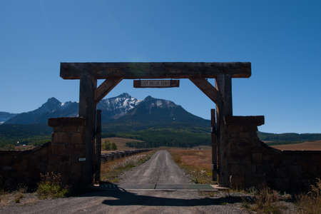 Gate of the Last Dollar Ranch in autumn with a view of the Dallas Divide on the back.