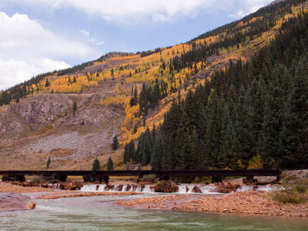 Railroad bridge. This train is in daily operation on the narrow gauge railroad between Durango and Silverton Colorado photo
