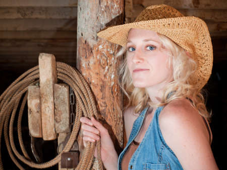 Country girl inside of an old barn. Stock Photo