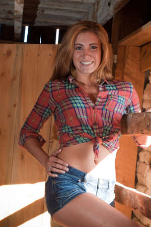 old people: Country girl inside of an old barn. Stock Photo