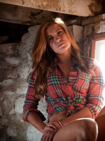 windows frame: Country girl inside of an old barn. Stock Photo