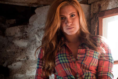 Country girl inside of an old barn. photo