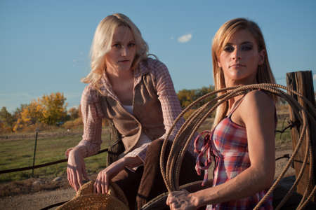 Two country girls on the farm. Stock Photo - 11098482
