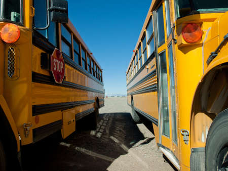 school buses: School buses parked near the high school. Stock Photo