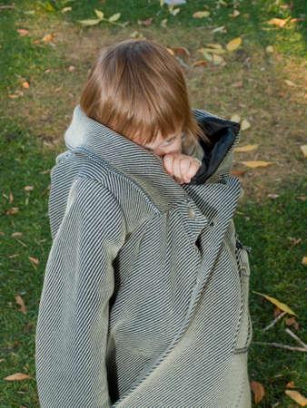 Girl toddler in autumn park.