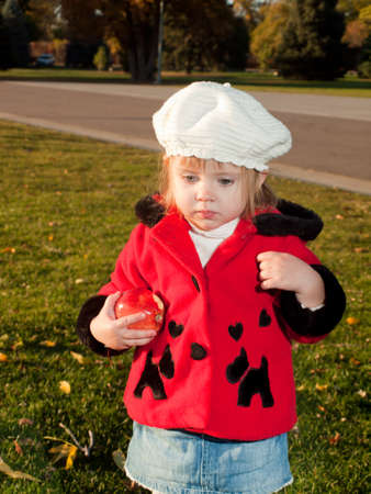 Girl toddler in autumn park. photo