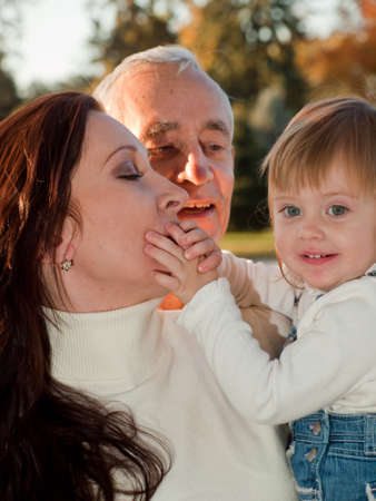 Father sharing a moment of happiness with his daughter and grandaughter. Stock Photo - 11219754
