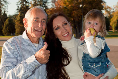 grandaughter: Father sharing a moment of happiness with his daughter and grandaughter. Stock Photo