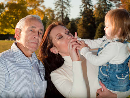 Father sharing a moment of happiness with his daughter and grandaughter. Stock Photo - 11130657