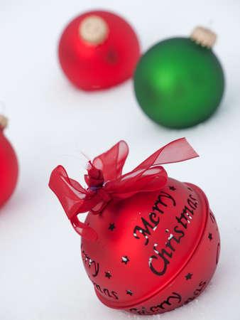 Christmas ornaments in virgin snow. Imagens - 11222687